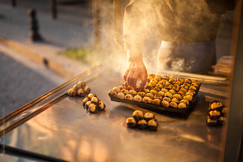 Man cooking chestnuts by Milles Studio for Stocksy United