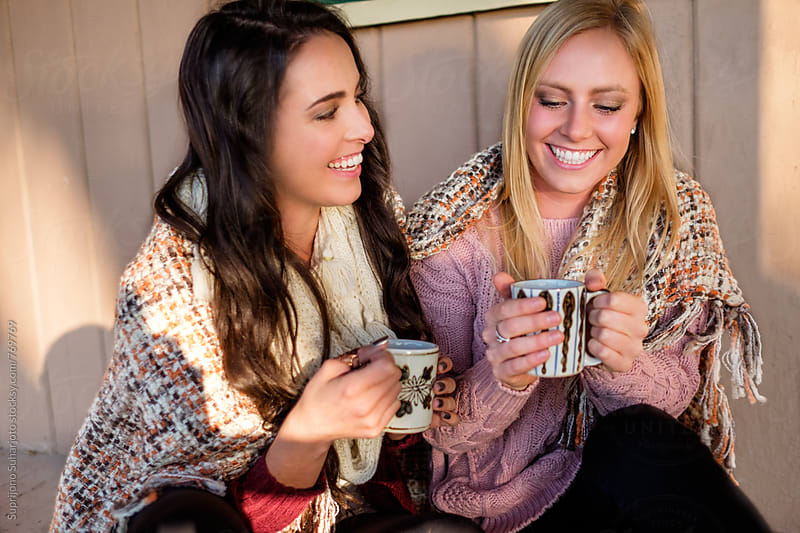 Female friends hanging out drinking coffee by Suprijono Suharjoto for Stocksy United