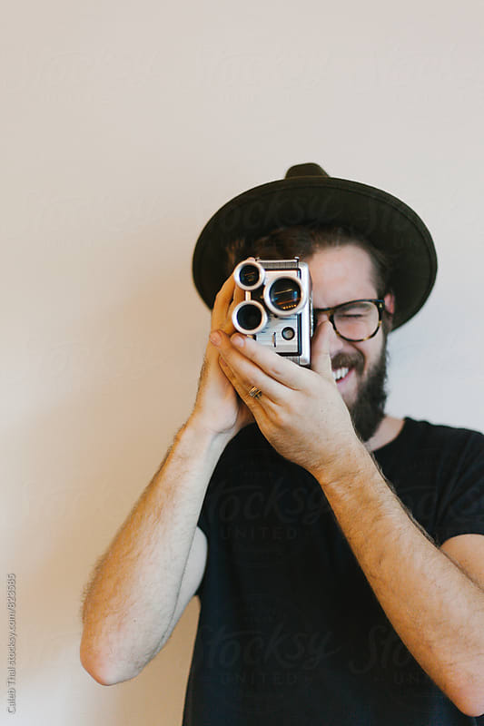 Young Man with Old Film Camera by Caleb Thal for Stocksy United