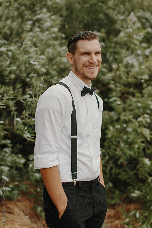 Groom Smiling by Sidney Morgan for Stocksy United