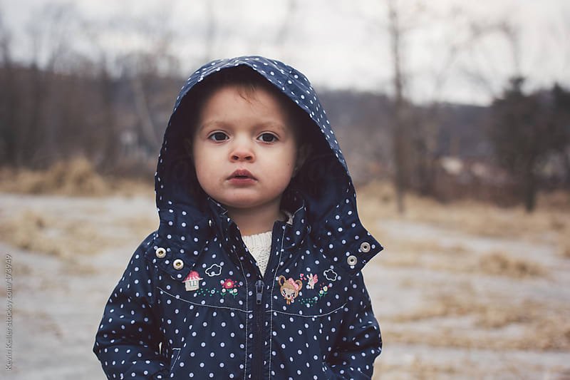 Toddler Girl Outdoors Standing on Ice by Kevin Keller for Stocksy United