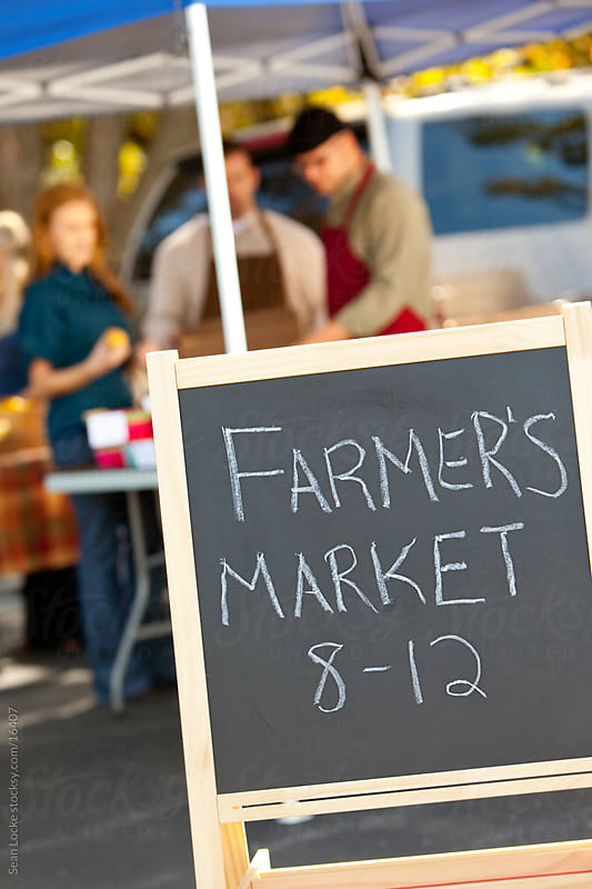 Farmer's Market: Sign Displaying Hours of Market by Sean Locke for Stocksy United