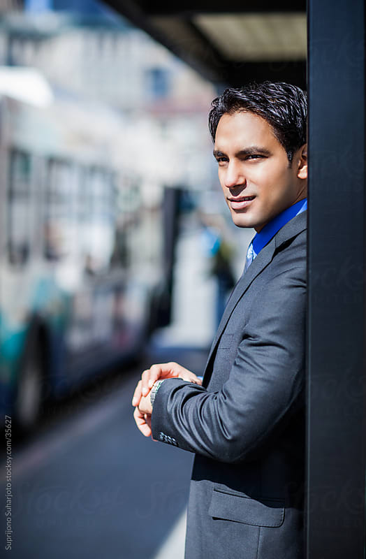 Indian businessman waiting for the bus by Suprijono Suharjoto for Stocksy United