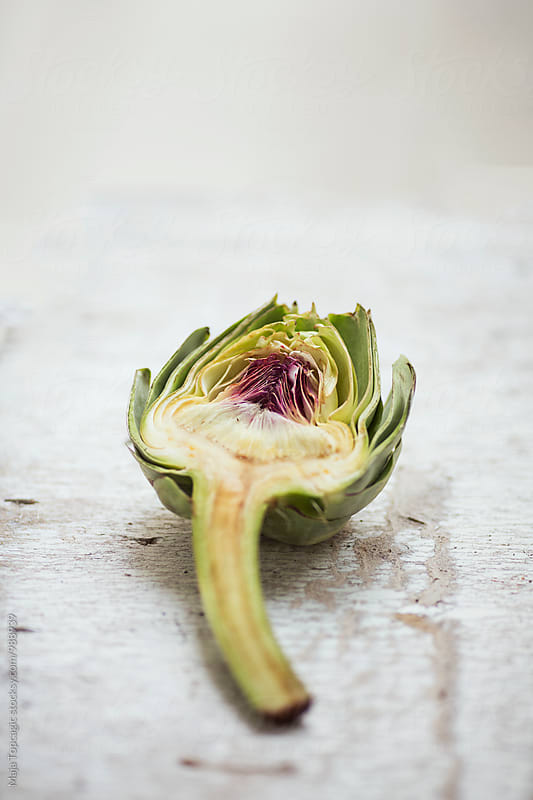 Artichoke on the table by Maja Topcagic for Stocksy United