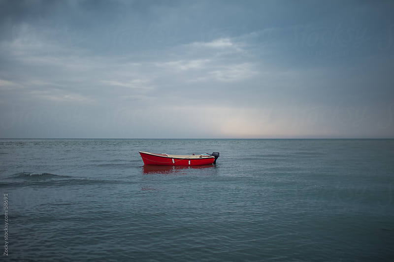 Lonely red boat by Zocky for Stocksy United