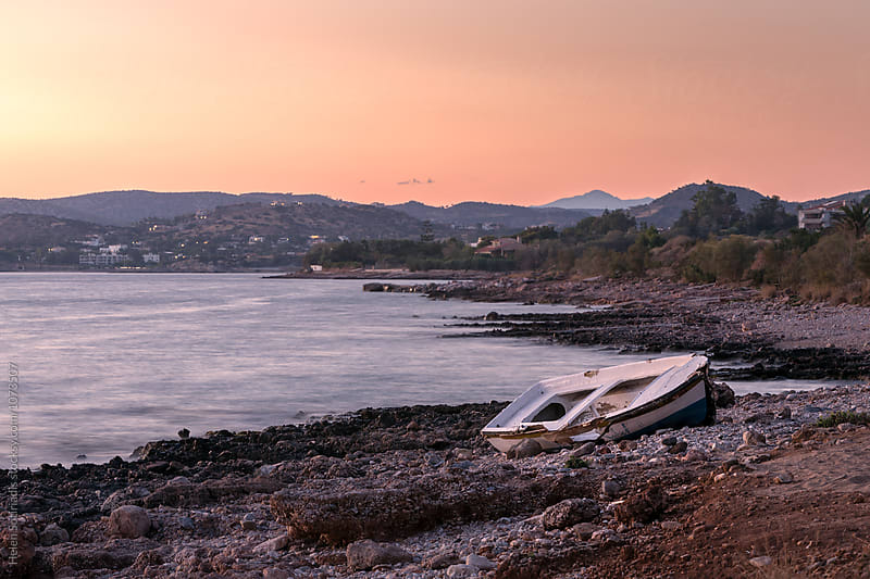 Rocky Shore with Broken Fishing Boat by Helen Sotiriadis for Stocksy United