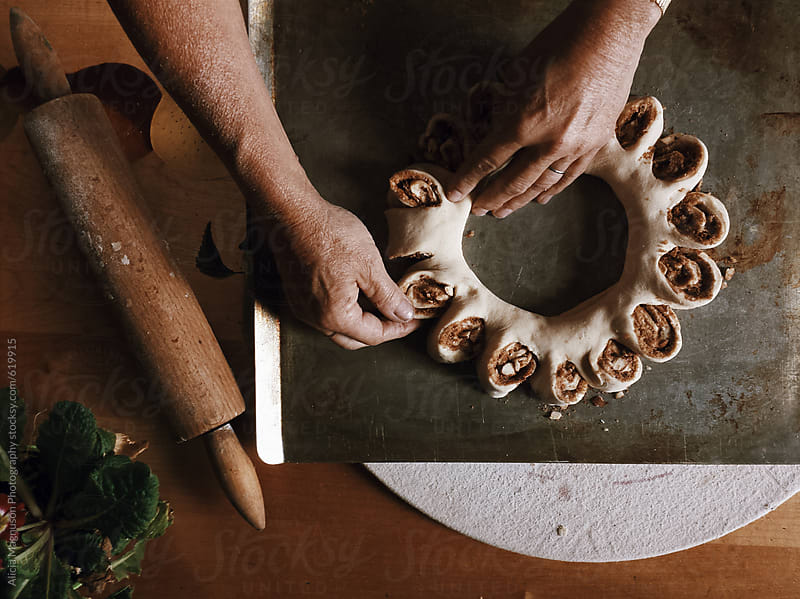 Woman Baking Swedish Tea Ring by Alicia Magnuson Photography for Stocksy United