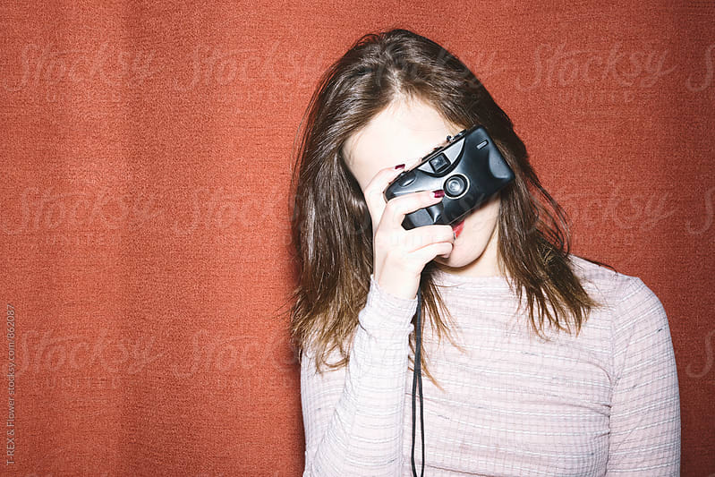 Close-up of young woman taking photo with old film camera by Danil Nevsky for Stocksy United
