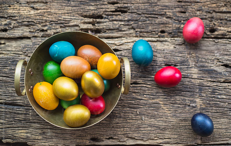 Easter eggs in golden container  by Jovo Jovanovic for Stocksy United