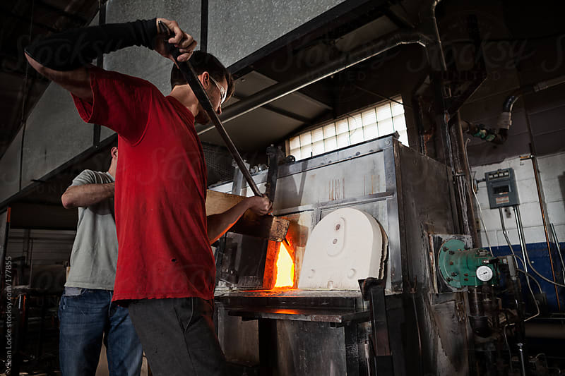 Glass: Gathering More Glass Onto Pipe From Furnace by Sean Locke for Stocksy United