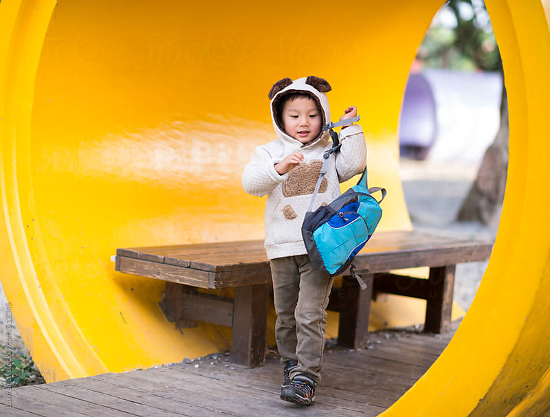 Asian Kid in Autumn Outfit with Bag at the Park by Lawren Lu for Stocksy United