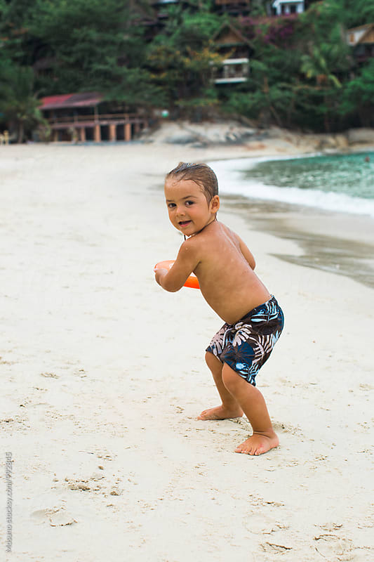 Little Boy Playing Frisbee at the Beach by Mosuno for Stocksy United