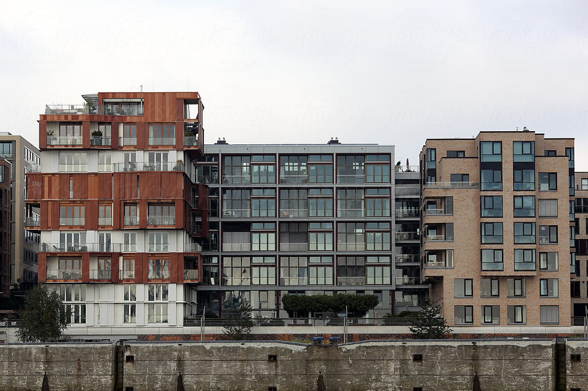 Modern apartment buildings in Hamburg harbour by Marcel - Stocksy United
