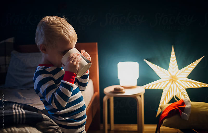Boy Drinks Milk at Bedtime  by Lumina for Stocksy United