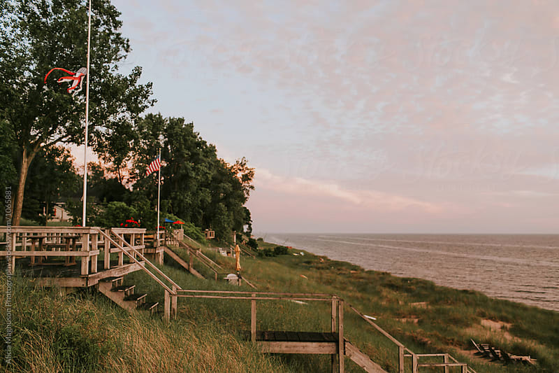 Stairs to Lake Michigan at Sunset by Alicia Magnuson Photography for Stocksy United