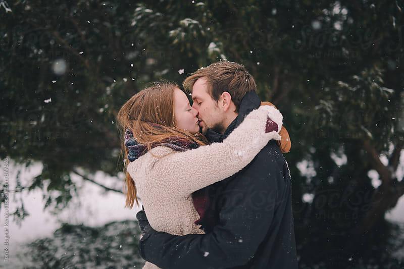 Lovely couple in the snowfall by Török-Bognár Renáta for Stocksy United