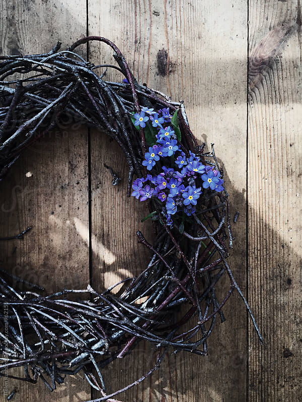 Twiggy wreath and Forget-Me-Nots by Helen Rushbrook for Stocksy United