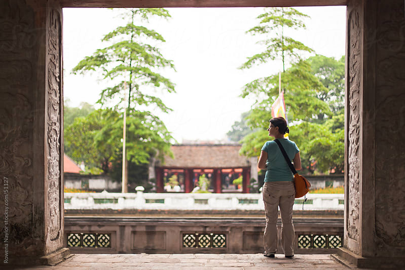 Tourist Admiring the view of Ancient  Buddhist Temples in Hanoi Vietnam by Rowena Naylor for Stocksy United