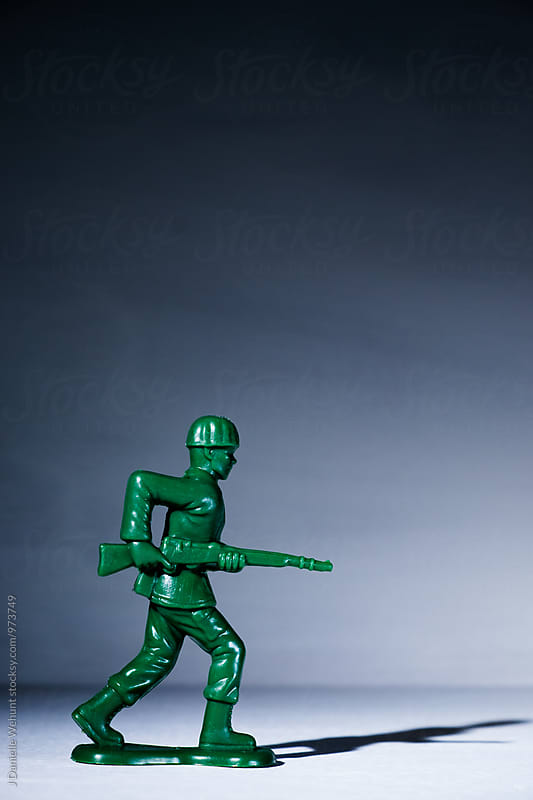 A toy soldier on a white background by J Danielle Wehunt for Stocksy United