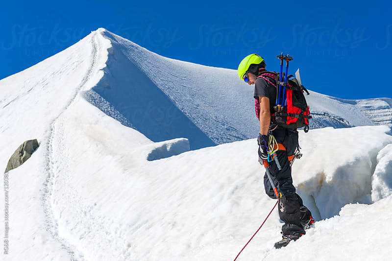 Mountaineer reaching the summit  by RG&B Images for Stocksy United