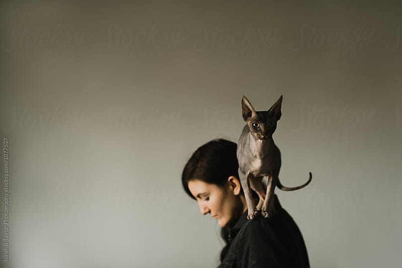 Cat on Woman by Isaiah & Taylor Photography for Stocksy United