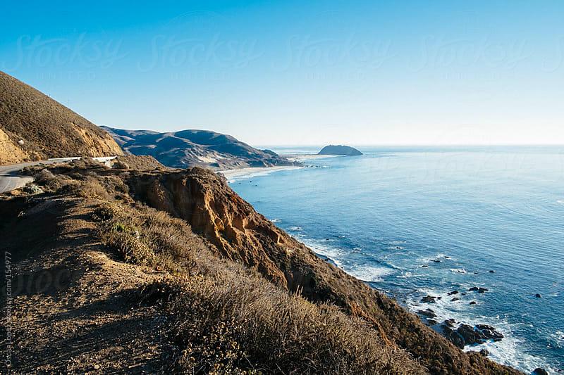 California coast on sunny day by Oscar Lopez for Stocksy United