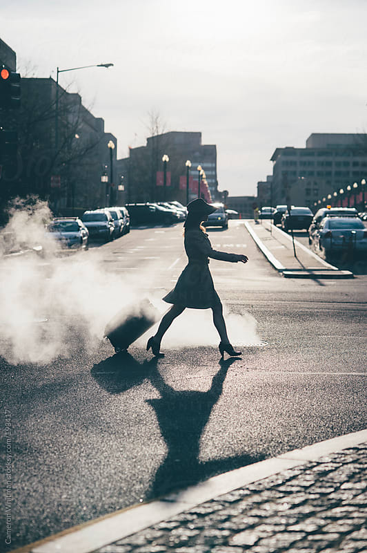 Attractive woman crossing the street by Cameron Whitman for Stocksy United