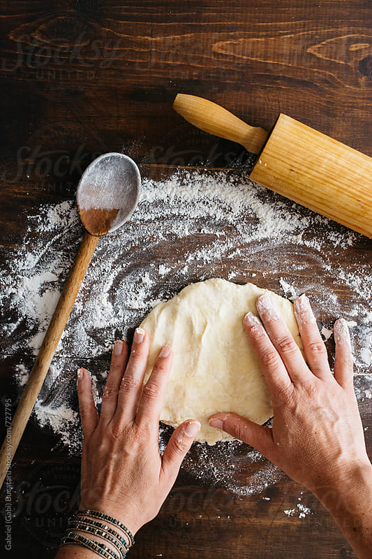 Woman's hands stretching pie dough by Gabriel (Gabi) Bucataru for Stocksy United