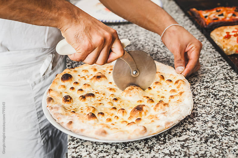 Cutter Pizza Wheel on a White Focaccia by Giorgio Magini for Stocksy United
