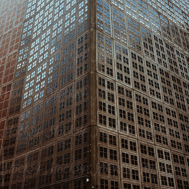 Arrray of square windows on a building by Gabriel Tichy for Stocksy United
