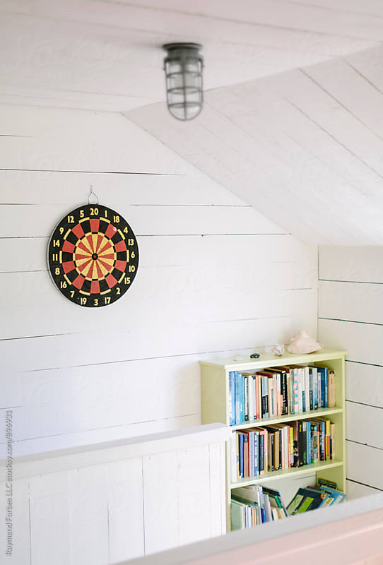 Dartboard at Summer Cottage by Raymond Forbes LLC for Stocksy United