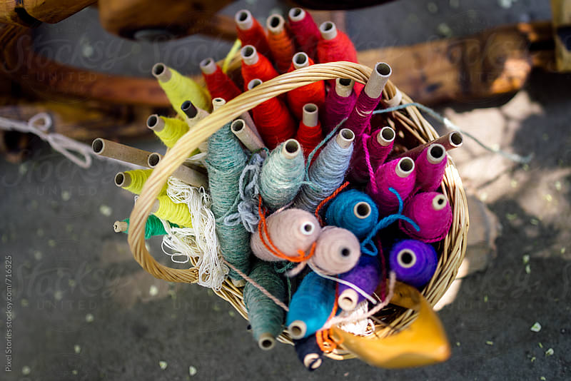 Colorful thread spools by Pixel Stories for Stocksy United
