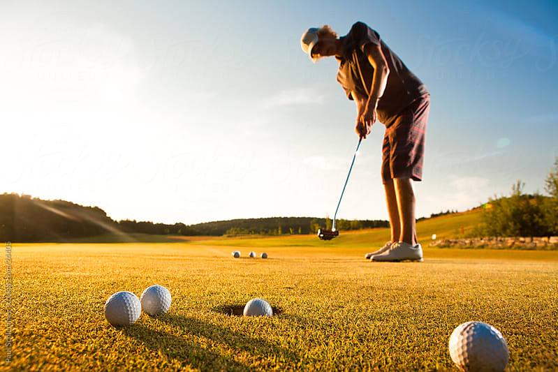 Sunset golf by Paul Schlemmer for Stocksy United