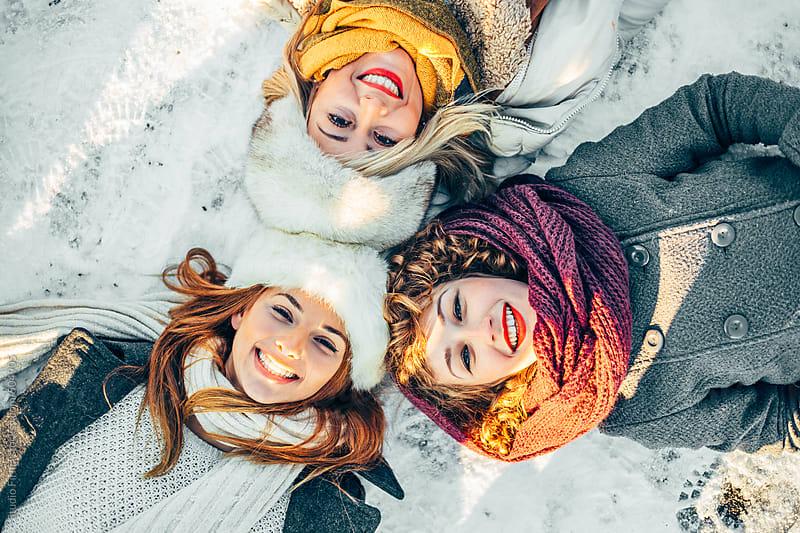Girlfriends having fun outside. by Studio Firma for Stocksy United