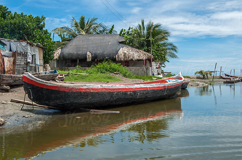 Canoe at the side of a lake in Colombia. by Mike Marlowe for Stocksy United