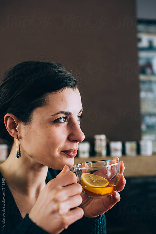 Beautiful woman drinking a cup of tea by michela ravasio for Stocksy United