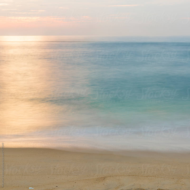 Minimalist seascape at sunset by Marilar Irastorza for Stocksy United