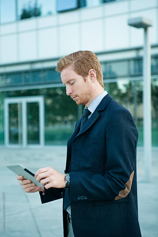 Businessman Using a Tablet by Lumina for Stocksy United