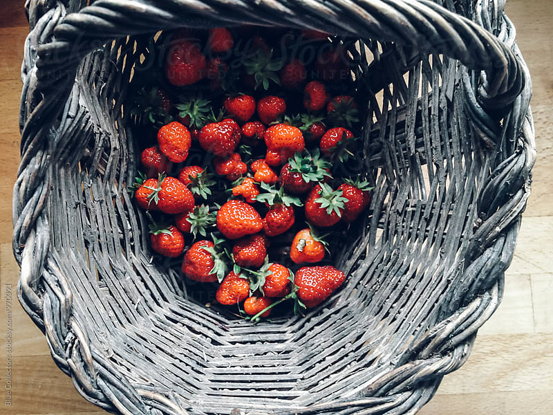 Wicker basket with strawberry by Jordi Rulló for Stocksy United