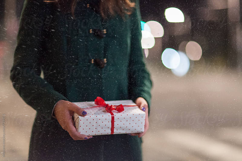 Anonymous Woman Holding Christmas Gift by Mosuno for Stocksy United