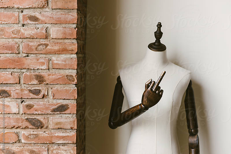 Mannequin showing rude finger by Maa Hoo for Stocksy United