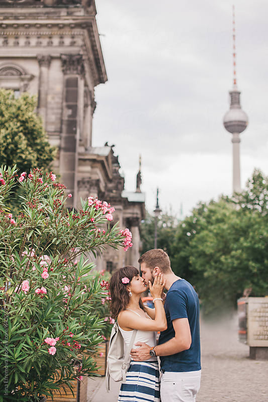 Couple kissing on front of TV-Tower in Berlin by Irina Efremova for Stocksy United