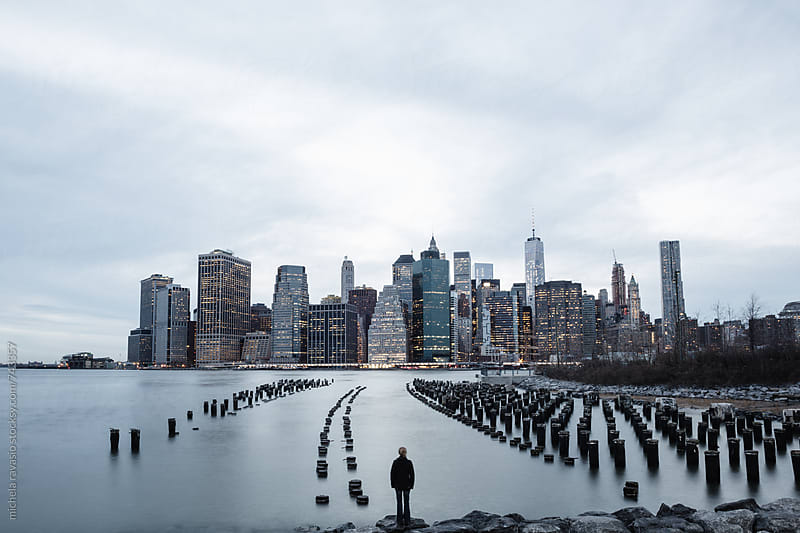 A person observing the cityscape of Manhattan, New York by michela ravasio for Stocksy United