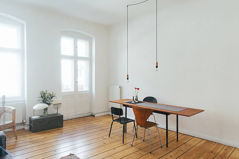 Wooden Table and Chairs in Bright White Minimalist Living Room by Julien L. Balmer for Stocksy United