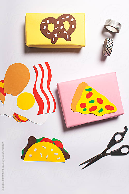 Hand made paper craft gift tags on white tabletop by Natalie JEFFCOTT for Stocksy United