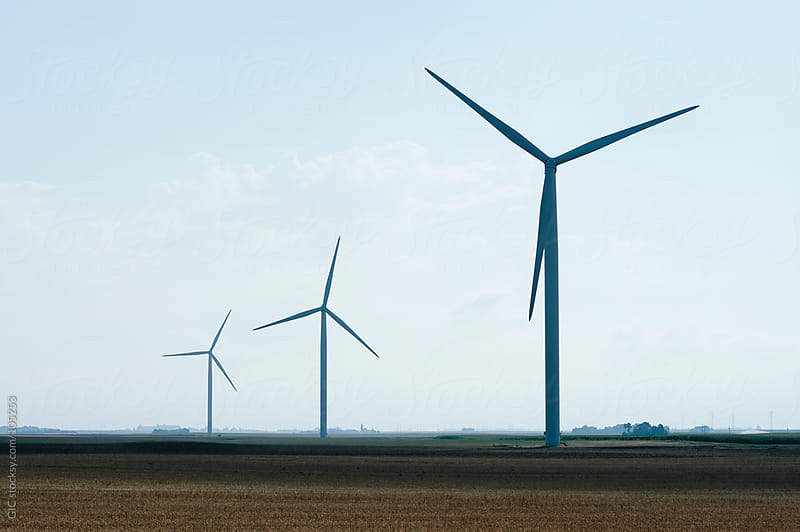 Wind turbines in a field by GIC for Stocksy United