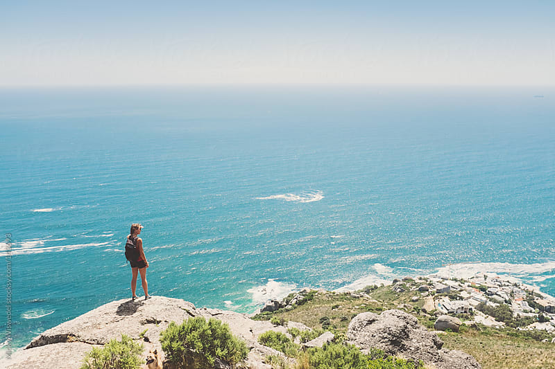 Female hiker over looking the sea from high up on the mountain by Micky Wiswedel for Stocksy United