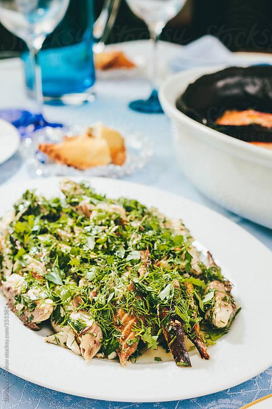 Fish salad with spices by Borislav Zhuykov for Stocksy United