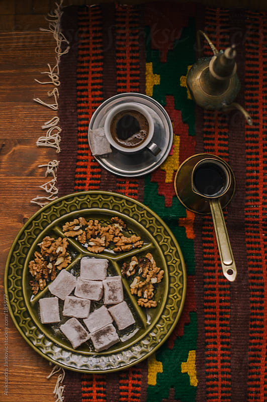 Oriental black coffee, turkish delight and nuts by Aleksandra Jankovic for Stocksy United