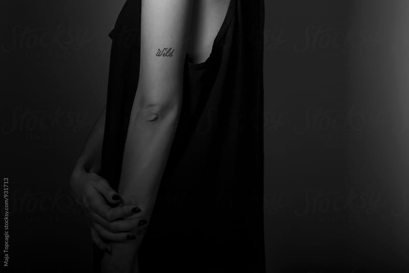 Tattoo on a model´s hand by Maja Topcagic for Stocksy United
